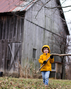 Boy playing on a farm